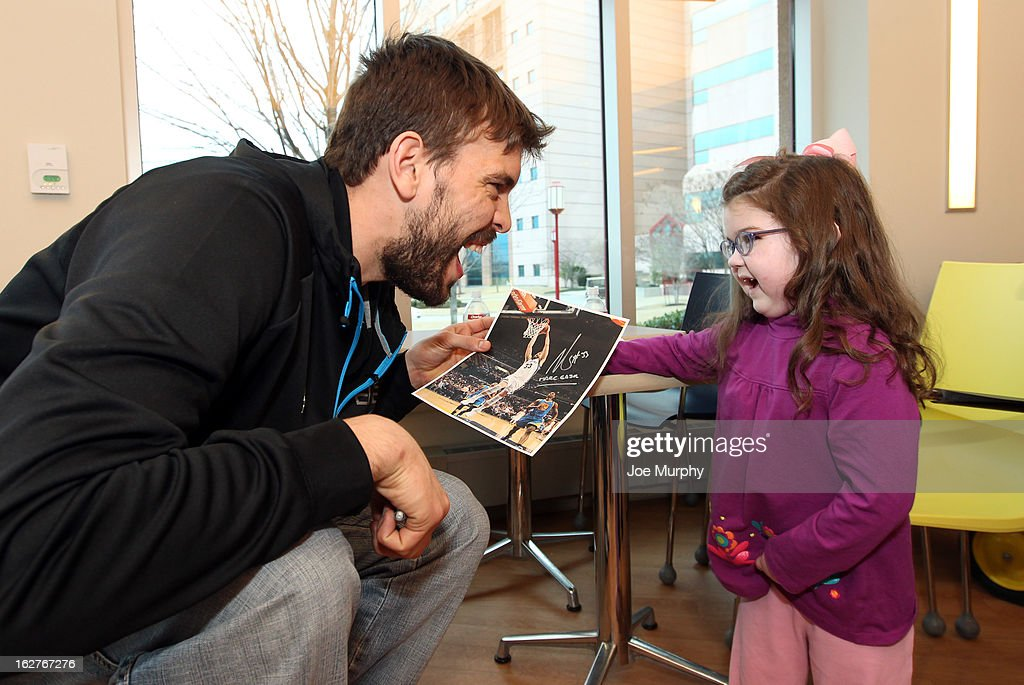 Marc Gasol #33 of the Memphis Grizzlies signs autographs for children on February 25, 2013 at St. Jude Children's Research Hospital in Memphis, Tennessee.