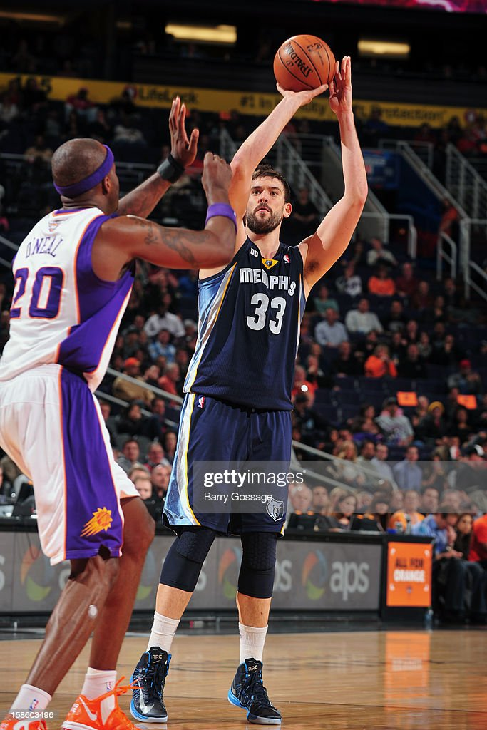 <a gi-track='captionPersonalityLinkClicked' href=/galleries/search?phrase=Marc+Gasol&family=editorial&specificpeople=661205 ng-click='$event.stopPropagation()'>Marc Gasol</a> #33 of the Memphis Grizzlies takes a shot against the Phoenix Suns on December 12, 2012 at U.S. Airways Center in Phoenix, Arizona.