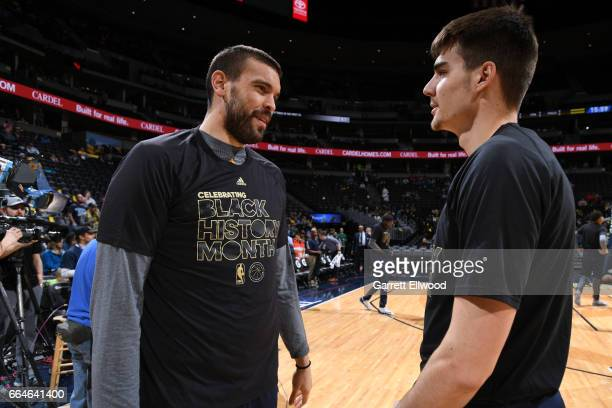 Marc Gasol of the Memphis Grizzlies talks with Juancho Hernangomez of the Denver Nuggets before a game on February 26 2017 at the Pepsi Center in...