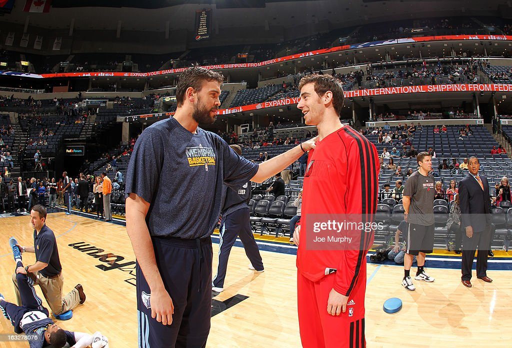 Marc Gasol #33 of the Memphis Grizzlies talks with Victor Claver #18 of the Portland Trail Blazers before a game on March 6, 2013 at FedExForum in Memphis, Tennessee.