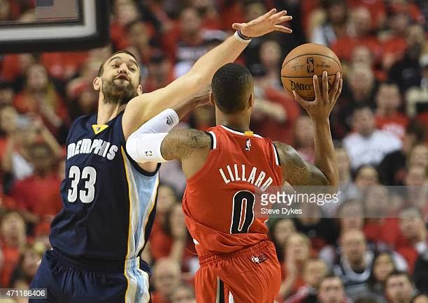 Marc Gasol of the Memphis Grizzlies tries to block the shot of Damian Lillard of the Portland Trail Blazers during the first quarter in Game Three of...