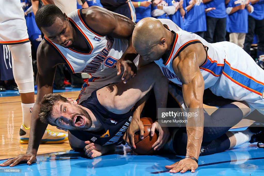 Marc Gasol #33 of the Memphis Grizzlies tries to control a loose ball against Serge Ibaka #9 and Derek Fisher #6 of the Oklahoma City Thunder in Game Two of the Western Conference Semifinals during the 2013 NBA Playoffs on May 7, 2013 at the Chesapeake Energy Arena in Oklahoma City, Oklahoma.