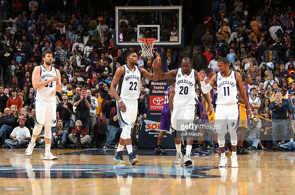 Marc Gasol #33, Rudy Gay #22, Quincy Pondexter #20, and Mike Conley #11 of the Memphis Grizzlies celebrate during a game against the Los Angeles Lakers on November 23, 2012 at FedExForum in Memphis, Tennessee.