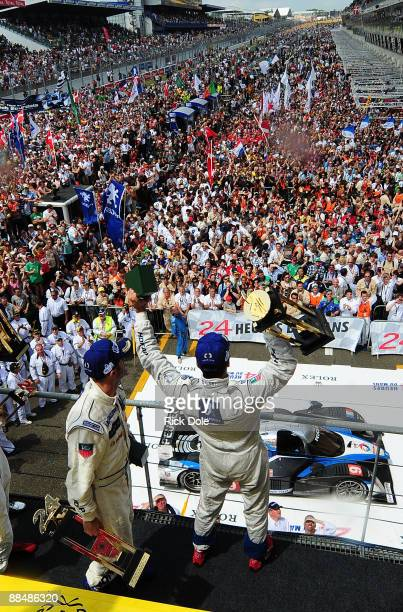 Marc Gene of Spain and David Brabham of Australia celebrate the victory of their Peugeot Sport Total Peugeot 908 during the 77th running of the Le...