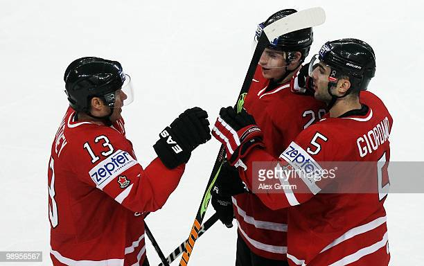 Marc Giordano of Canada celebrates his team's second goal with team mates Kyle Cumiskey and Ray Whitney during the IIHF World Championship group B...