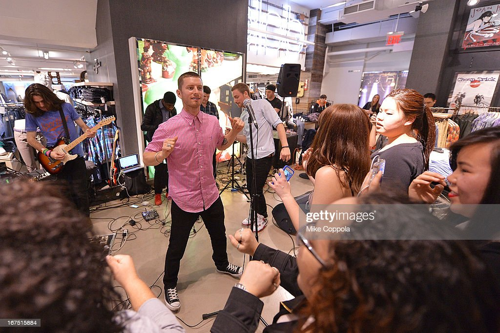 Marc Griffin (L) and Tyler Cordy of the band 2AM Club perform as Sportiqe and ESPN host a NBA Playoff Party at Bloomingdale's 59th Street Store on April 25, 2013 in New York City.