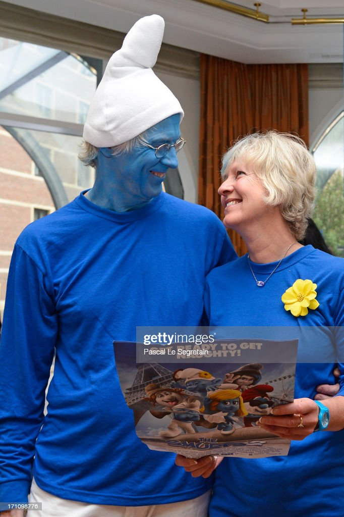 Marc Guerin and Veronique Culliford, the daughter of creator of The Smurfs, cartoonist Peyo, attend a ceremony as part of Global Smurfs Day celebrations on June 22, 2013 at Galerie Horta in Brussels, Belgium.