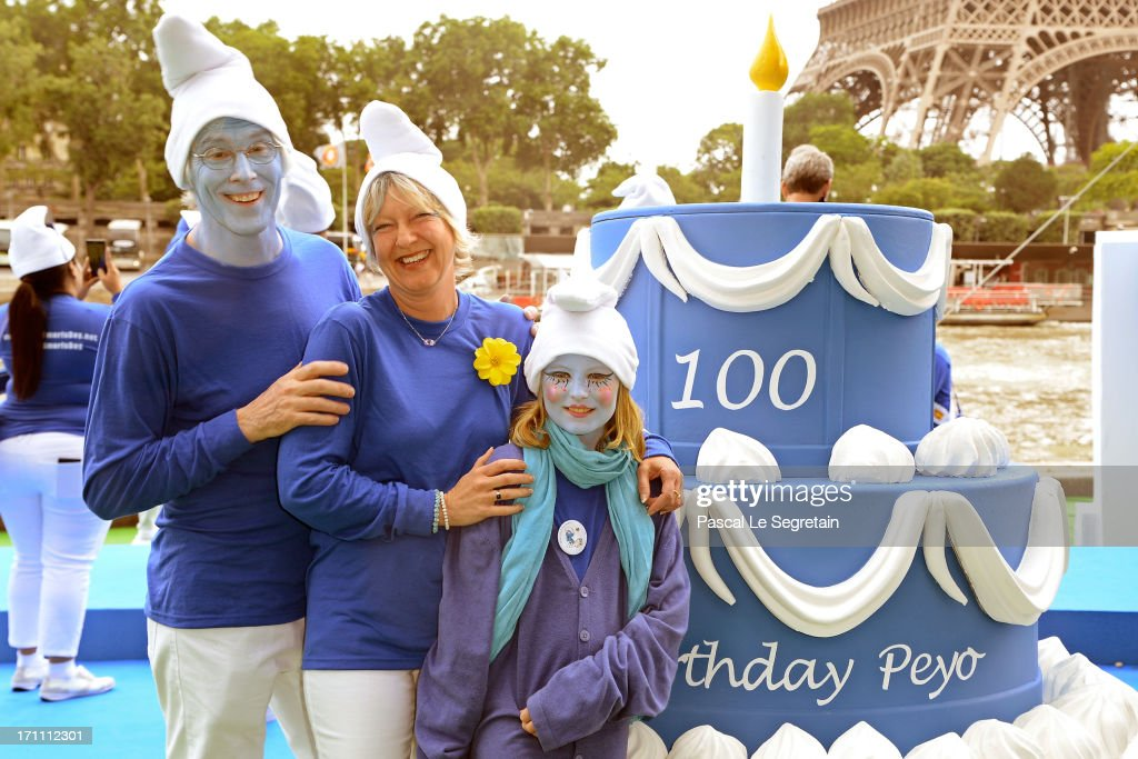 Marc Guerin, Veronique Culliford, the daughter of late cartoonist Peyo, the creator of The Smurfs, and Nina Guerin Culliford participates to celebrations as part of Global Smurfs Day on June 22, 2013 in Paris, France.