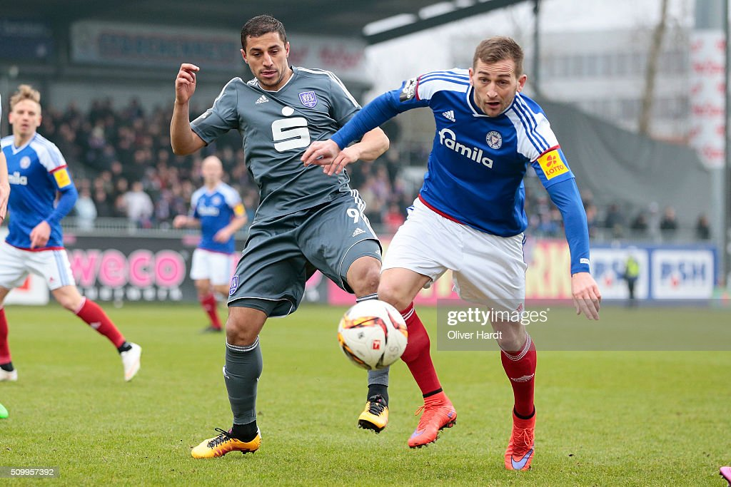 Marc Heider (R) of Kiel and Hall Savran (L) of Osnabrueck compete for the ball during the 3 liga match between Holstein Kiel and VfL Osnabrueck at Holstein-Stadion on February 13, 2016 in Kiel, Germany.