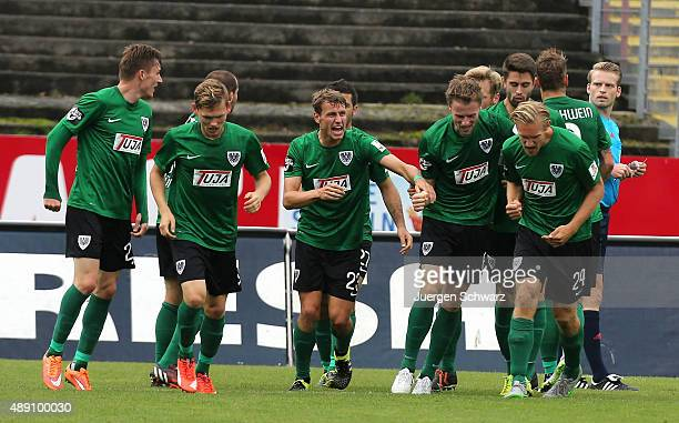 Marc Heitmeier of Muenster celebrates with teammates after scoring during the Third League match between Preussen Muenster and Fortuna Koeln at...