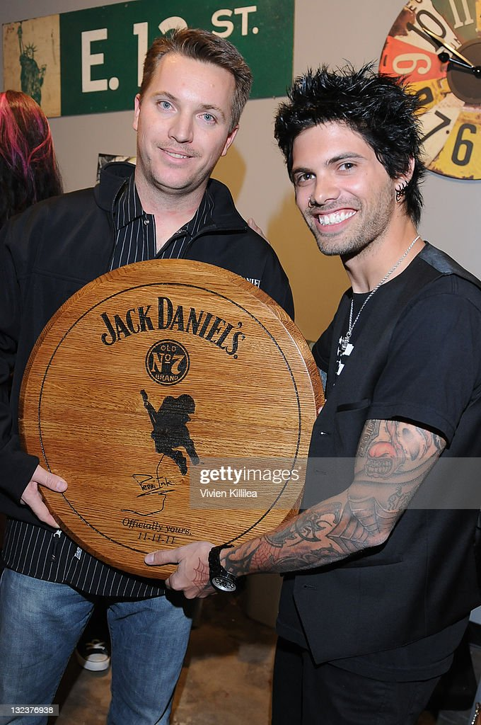 Marc Hindorff of Jack Daniels presents the Perri Ink Cartel with an award at the PERRI INK. Cartel Store Opening on November 11, 2011 in Los Angeles, California.