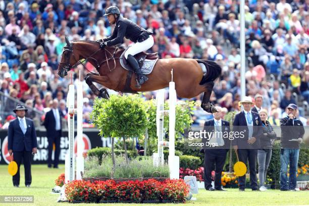 Marc HOUTZAGER of Netherlands riding STERREHOF'S CALIMERO during the Rolex Grand Prix part of the Rolex Grand Slam of Show Jumping of the World...