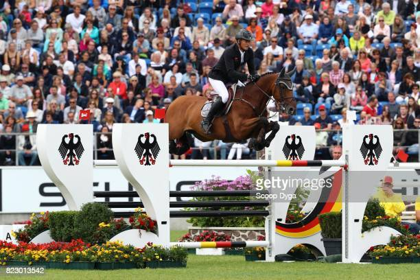 Marc HOUTZAGER riding STERREHOF'S CALIMERO during the Rolex Grand Prix part of the Rolex Grand Slam of Show Jumping of the World Equestrian Festival...