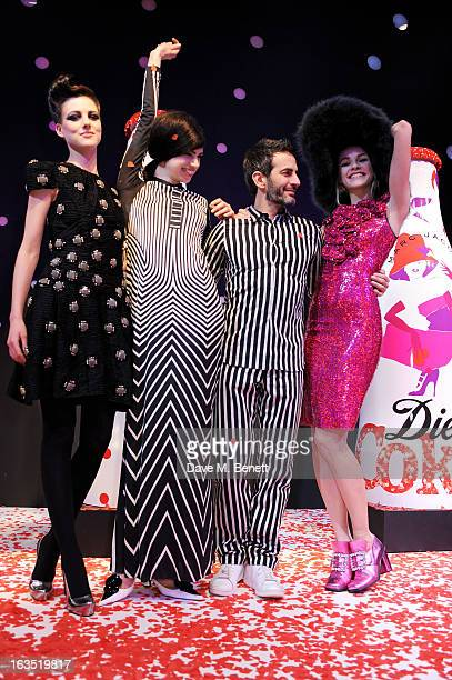 Marc Jacobs poses with models Eliza Cummings and Lily McMenamy and Ginta Lapina attend a party celebrating 30 years of Diet Coke and announcing...