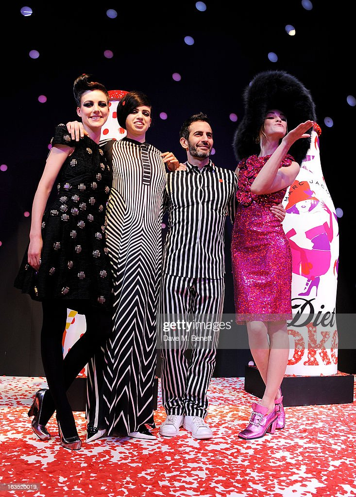 Marc Jacobs (2R) poses with models Eliza Cummings, Lily McMenamy and Ginta Lapina attend a party celebrating 30 years of Diet Coke and announcing designer Marc Jacobs as Creative Director for Diet Coke in 2013 at the German Gymnasium Kings Cross on March 11, 2013 in London, England.