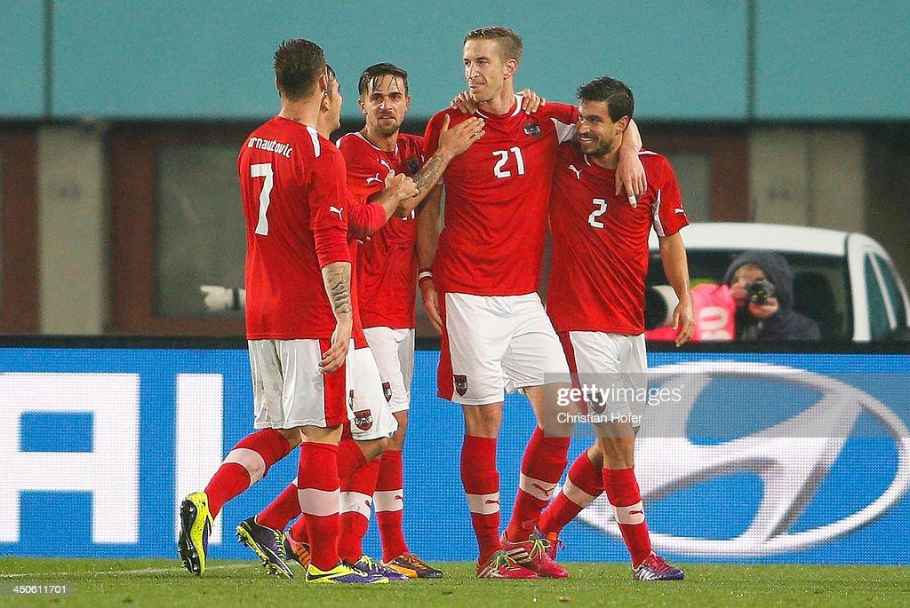 Marc Janko celebrates with Marko Arnautovic Martin Harnik and Gyoergy Garics of Austria after scoring the winning goal during the International...
