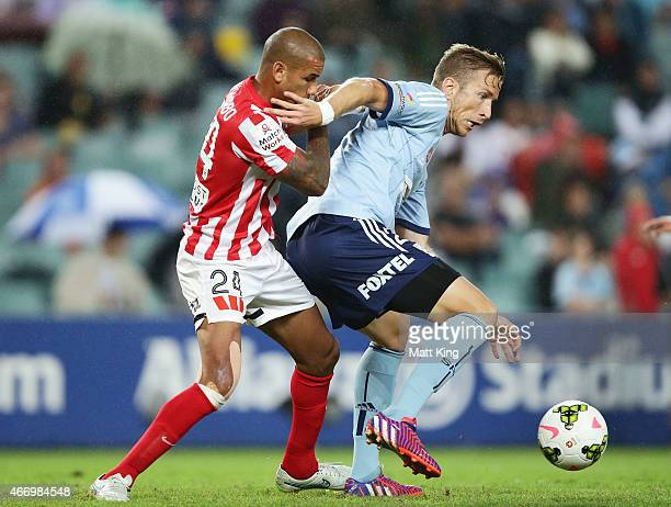 Marc Janko of Sydney FC is challenged by Patrick Kisnorbo of Melbourne City during the round 22 ALeague match between Sydney FC and Melbourne City FC...
