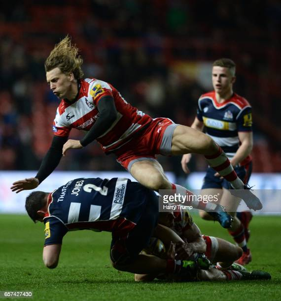 Marc Jones of Bristol Rugby is tackled by Jonny May of Gloucester Rugby and Billy Twelvetrees of Gloucester Rugby during the Aviva Premiership match...
