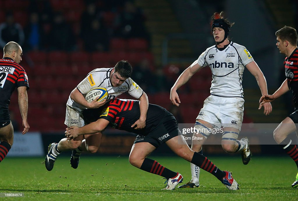 Marc Jones of Sale is tackled during the Aviva Premiership match between Saracens and Sale Sharks at Vicarage Road on January 6, 2013 in Watford, England.
