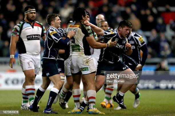 Marc Jones of Sale punches Maurie Fa'asavalu of Harlequins during the Aviva Premiership match between Sale Sharks and Harlequins at the Salford City...