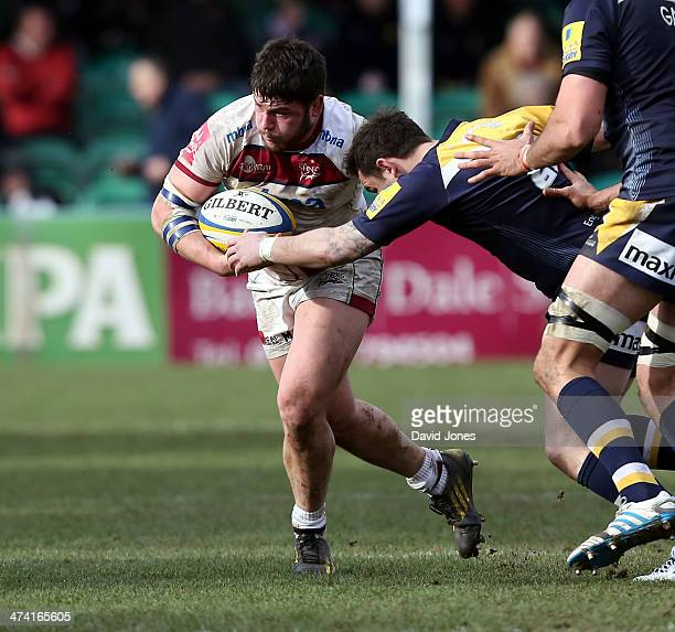 Marc Jones of Sale Sharks is tackled by Ryan Lamb of Worcester Warriors during the Aviva Premiership match between Worcester Warriors and Sale Sharks...