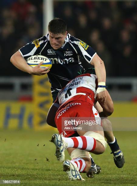 Marc Jones of Sale Sharks is tackled by Sione Kalamafoni of Gloucester during the Aviva Premiership match between Sale Sharks and Gloucester at the...