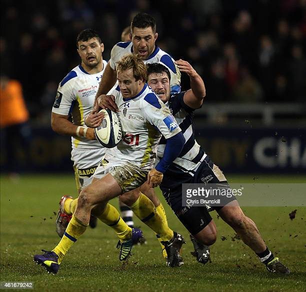 Marc Jones of Sale Sharks tackles Nick Abendanon of ASM Clermont Auvergne during the European Rugby Champions Cup match between Sale Sharks and ASM...