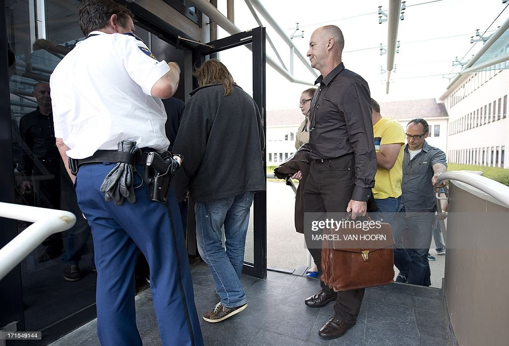 Marc Josemans (C), owner of coffee shop Easy Going, arrives at the courthouse of Maastricht, on June 26, 2013. Three coffee shop owners and three employees are sentenced for selling cannabis to non-residents. The six were ordered to pay fines of between 250 and 2,500 euros, plus a contingent of 75 hours of community service. AFP ANP MARCEL VAN HOORN netherlands out - belgium out