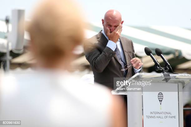 Marc Kalkman pauses as he introduces his wife Tennis Hall of Fame inductee Monique Kalkmanvan den Bosch during enshrinement ceremonies at the...
