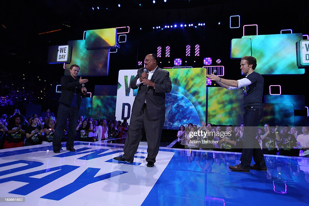Marc Kielburger, Martin Luther King III and Craig Kielburger speak during the We Day Minnesota event at the Xcel Energy Center in St. Paul, Minnesota on October 8, 2013