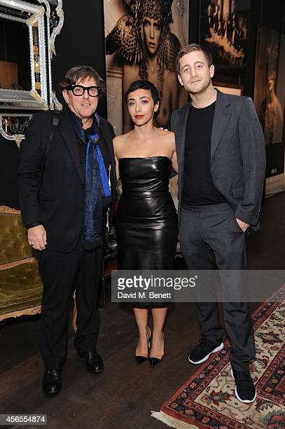 Marc Lagrange Mashael Al Rushaid and Tyrone Wood attend a private view of the Marc Lagrange exhibition at HEIST Gallery on October 2 2014 in London...