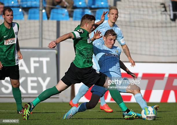 Marc Lais of Chemnitz challenges Marcus Piossek of Muenster during the 3rd League match between Chemnitzer FC and Preussen Muenster at Stadion an der...