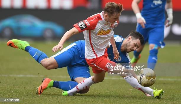Marc Lais of Jahn Regensburg challenges Bernd Rosinger of Sportfreunde Lotte during the 3 Liga match between Jahn Regensburg and Sportfreunde Lotte...
