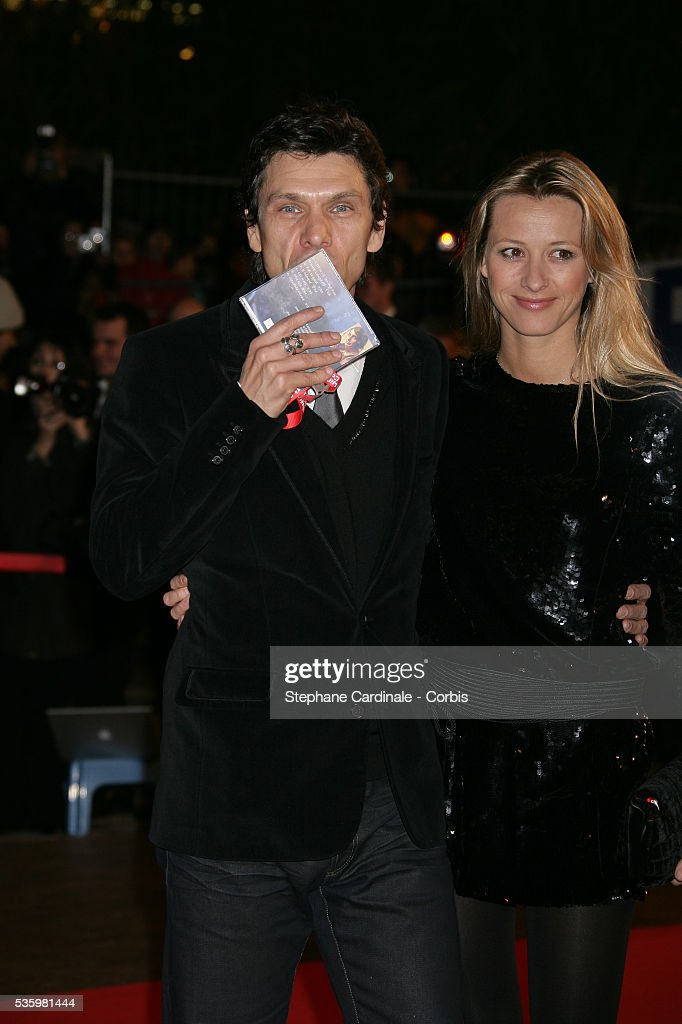 Marc Lavoine with his wife Sarah arriving at the Cannes festival palace to attend the NRJ Music Awards.