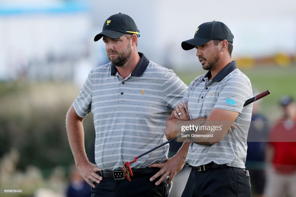 Marc Leishman and Jason Day of Australia and the International Team look on during Friday four-ball matches of the Presidents Cup at Liberty National Golf Club on September 29, 2017 in Jersey City, New Jersey.