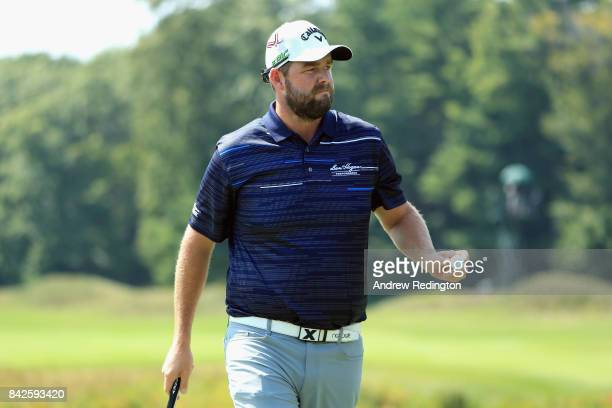 Marc Leishman of Australia acknowledges fans after putting on the second green during the final round of the Dell Technologies Championship at TPC...