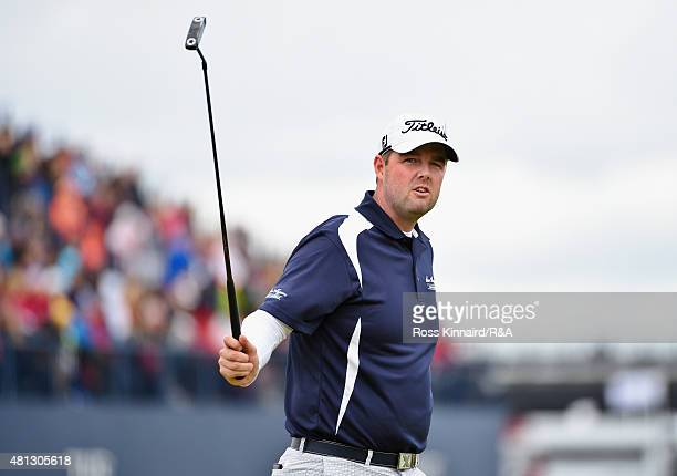 Marc Leishman of Australia acknowledges the crowd after holing his par putt on the 17th green during the third round of the 144th Open Championship...