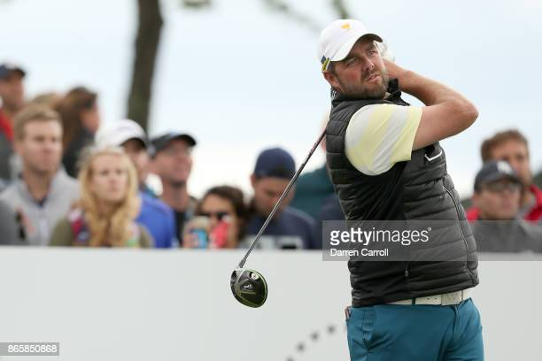 Marc Leishman of Australia and the International Team plays a tee shot during the afternoon fourball matches at the Presidents Cup at Liberty...