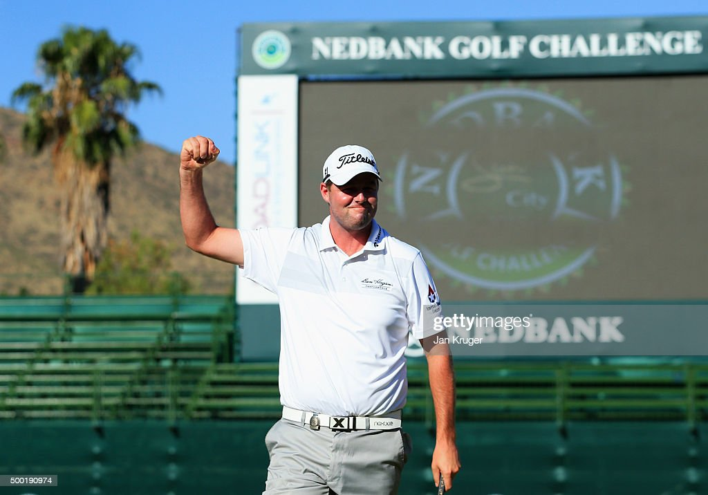 Marc Leishman of Australia celebrates victory on the 18th green during the final round on day four of the Nedbank Golf Challenge at Gary Player CC on...