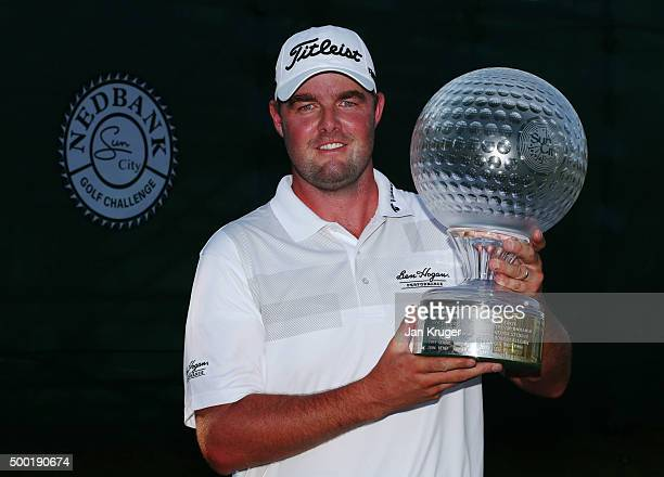 Marc Leishman of Australia celebrates victory with the trophy after the final round on day four of the Nedbank Golf Challenge at Gary Player CC on...