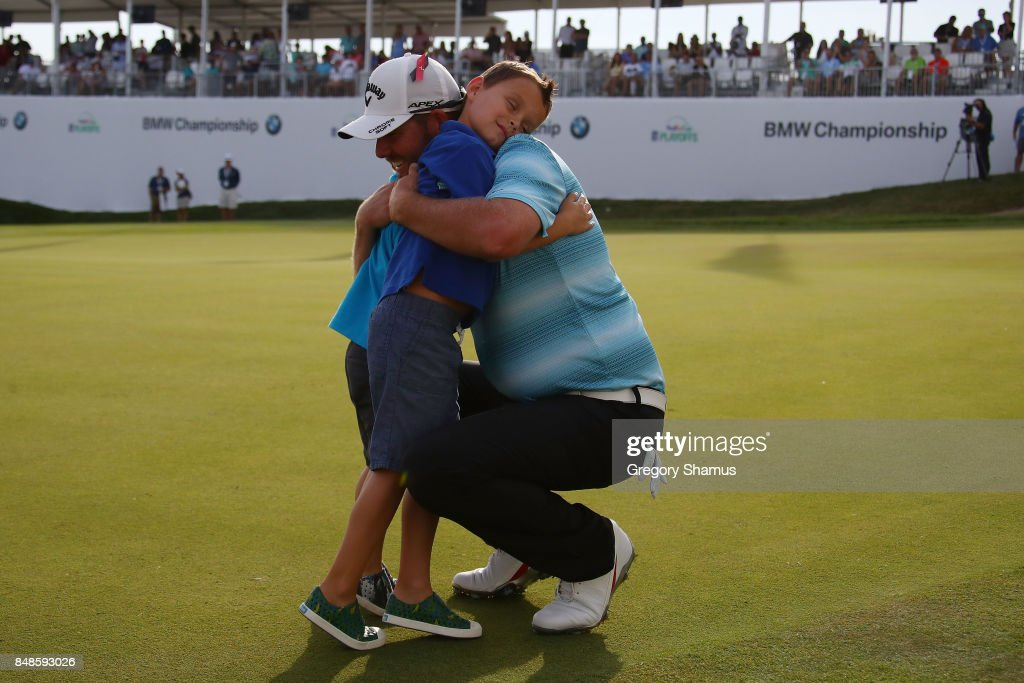 Marc Leishman of Australia celebrates with his two young sons Oliver and Harry after winning the BMW Championship at Conway Farms Golf Club on September 17, 2017 in Lake Forest, Illinois.