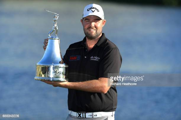 Marc Leishman of Australia celebrates with the winner's trophy on the 18th green after the final round of the Arnold Palmer Invitational Presented By...