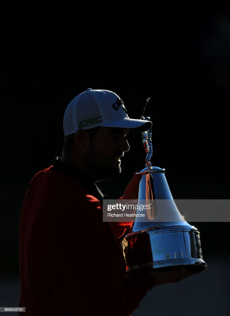 Marc Leishman of Australia celebrates with the winner's trophy on the 18th green after the final round of the Arnold Palmer Invitational Presented By MasterCard at Bay Hill Club and Lodge on March 19, 2017 in Orlando, Florida.