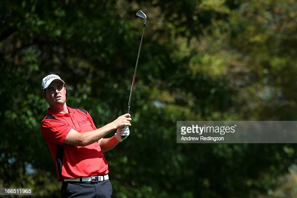 Marc Leishman of Australia hits a shot on the fourth hole during the third round of the 2013 Masters Tournament at Augusta National Golf Club on...
