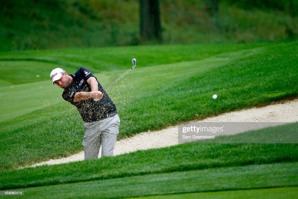 <a gi-track='captionPersonalityLinkClicked' href=/galleries/search?phrase=Marc+Leishman&family=editorial&specificpeople=2582046 ng-click='$event.stopPropagation()'>Marc Leishman</a> of Australia hits out of a bunker on the 16th hole during the third round of the World Golf Championships-Bridgestone Invitational at Firestone Country Club South Course on August 2, 2014 in Akron, Ohio.