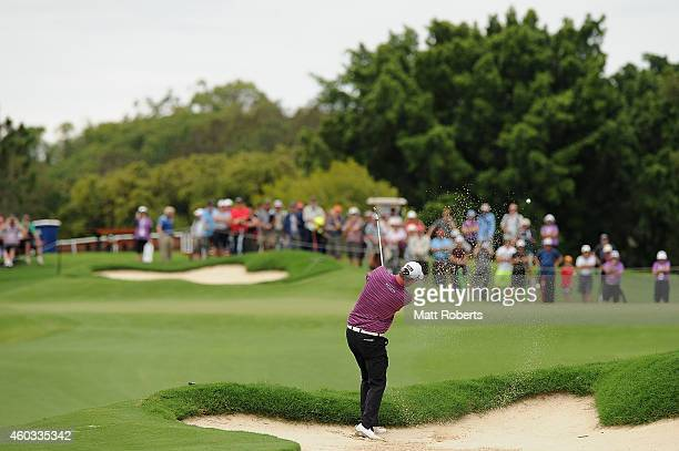Marc Leishman of Australia hits out of the bunker on the 8th hole during day two of the 2014 Australian PGA Championship at Royal Pines Resort on...