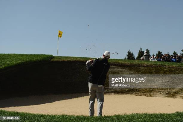 Marc Leishman of Australia hits out of the bunker on the 8th hole during the final round of the CJ Cup at Nine Bridges on October 22 2017 in Jeju...