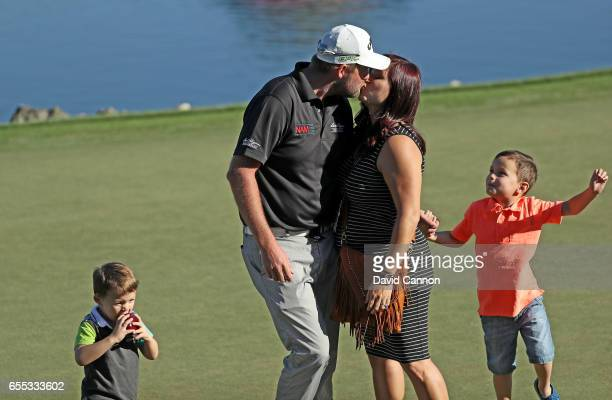 Marc Leishman of Australia is embraced by his wife Audrey and his two young sons Oliver and Harvey after his one shot victory in the final round of...