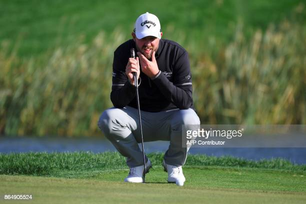 Marc Leishman of Australia lines up a putt on the 18th green during the final round of the CJ Cup at Nine Bridges in Jeju Island on October 22 2017 /...