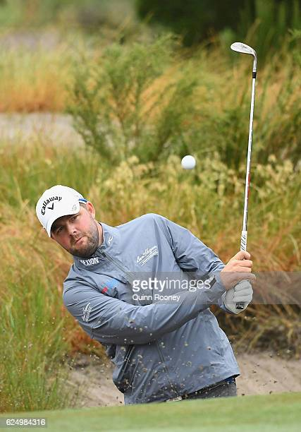 Marc Leishman of Australia plays out of the bunker ahead of the 2016 World Cup of Golf at Kingston Heath Golf Club on November 22 2016 in Melbourne...